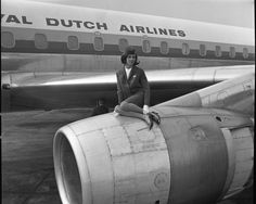KLM - Stewardess posing on top of aircraft engine: #Aviation #Airline #Aircraft