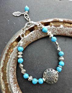 Indian basket charm, turquoise stone, silver bracelet. Bohemian charm bracelet.