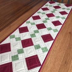 The request was for a red and green dresser runner, nothing fancy. The challenge was to work with these colors and create somethin...