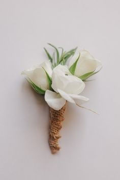 Nick Carter's Rustic Boutonniere    Photography: Kris Kan   Read More:  http://www.insideweddings.com/weddings/lauren-kitt-and-nick-carter/605/