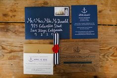 Wood & Blue Nautical Wedding Invites  Photography: Luke & Katherine Griffin for Max & Friends Read More: http://www.insideweddings.com/weddings/tent-wedding-with-chic-nautical-theme-on-la-playa-bay-in-san-diego/737/