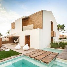 Ernesto Pereira updates a coastal Portuguese  home with timber-clad cutaways