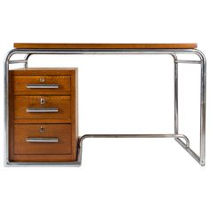 Italian Modernist Oak Desk by Cova, Italy circa 1930 | From a unique collection of antique and modern desks at https://www.1stdibs.com/furniture/storage-case-pieces/desks/