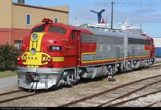 316 Atchison, Topeka & Santa Fe (ATSF) EMD at Galveston, Texas by Kevin Andrusia. My favorite Engine Diesel Locomotive, Steam Locomotive, Bnsf Railway, Railroad History, Covered Wagon, Train Pictures, Old Trains, Train Engines, Model Train Layouts