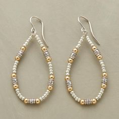 "SHIMMERING TEARDROP EARRINGS -- Silvery seed beads fill the gaps between blossom-stamped sterling silver beads flanked with 12kt goldplate spheres. French wires. Exclusive. Handmade in USA. 2""L."