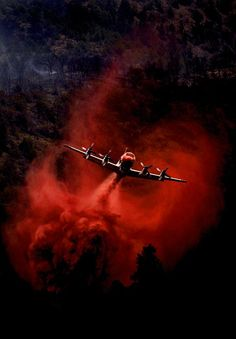 Fire retardant and/or water is dropped on forest fires by air using tanker plains and helicopters with bucket tanks.