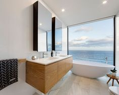Wooden vanity adds warmth and contrast to the lovely contemporary bathroom [Design: John Wheatley UA Creative] Contemporary Bathroom Designs, Modern Bathroom, Master Bathroom, Palaces, Villas, Spa Inspired Bathroom, Vintage Bathtub, Wooden Vanity, Australian Homes