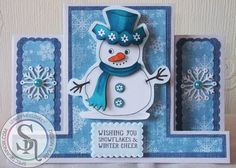 A stepper card made with stamps and backing papers from the new Romany Christmas range by Abigail Mills. More details can be found at http://stampingbubbles.blogspot.co.uk/2015/08/winter-cheer.html
