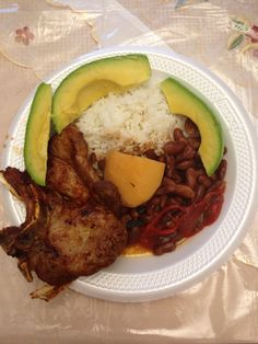 Rice and Beans with Pork Chop and Avocado Arroz con Habichuela y Chuleta con Aguacate