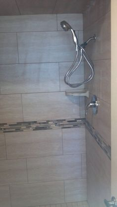 12x24 tile shower with accent