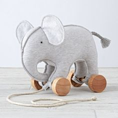 Little ones will love taking walks in the company of our Zoo Crew Pull Toy. Each animal pull toy features removable wheels and a pull-string.