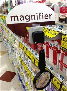 Here a traditional Magnifying Glass Teathered at Shelf Edge allows shoppers to enlarge any type to the size they desire by varying the focal distance. Glass Shelves Kitchen, Visual Merchandising Displays, Magnifying Glass, Guerrilla, Display Shelves, Retail Design, Pharmacy, Focal Distance, Cool Stuff