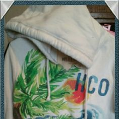 Hollister hoodie with HCO beach design! Gently used in great condition no stains no holes. Hollister Tops Sweatshirts & Hoodies