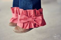 Ruffle-And-Bow-Pant-Leg-Tutorial: finished off with a pretty bow.  It's a cute accent to a pair of pants, and can also add an extra inch or two to the length of a pair of outgrown pants.