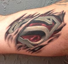 What does superman tattoo mean? We have superman tattoo ideas, designs, symbolism and we explain the meaning behind the tattoo. Arm Tattoo, Skin Tear Tattoo, Ripped Skin Tattoo, Body Art Tattoos, Sleeve Tattoos, Tatoos, Maori Tattoos, Superman Tattoos, Marvel Tattoos