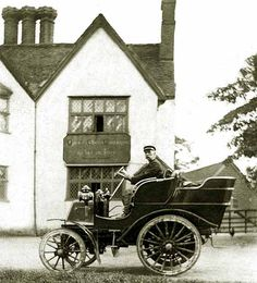 cca 1900 Locomobile Locosurrey. These were steam cars. It is interesting to note that the front of the car is fitted with a  condensing radiator  which was mandatory for UK market