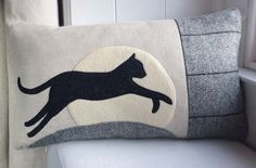 https://www.seaforthdesigns.com/products/handmade-leaping-cat-cushion