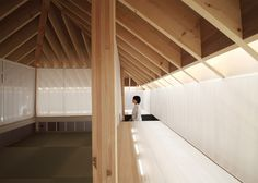 Translucent curtains surround a mezzanine tea room in the heart of this Japanese home