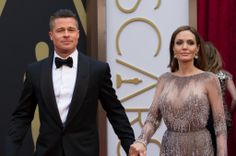 Oscar®-nominated for Best Picture, Brad Pitt arrives with Angelina Jolie for the live ABC Telecast of The 86th Oscars® at the Dolby® Theatre on March 2, 2014 in Hollywood, CA. credit: Aaron Poole / ©A.M.P.A.S.
