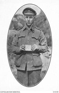 "Cpt. Cutherbert Clive Finaly, 17th Battalion, holding a cigarette box thrown by the Turks into a trench at Quinn's Post, Gallipoli Nov. 1915. Written on the box ""Prenez avec plaisir notre heros ennemies. Envoyez du lait"". Australian War Memorial, H15199."