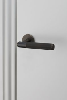DOOR LEVER HANDLE / SMOKED BRONZE by Buster + Punch.