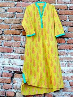 An ochre pakistani kurti ... with pink feather print