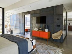 Piercing the envelope of the house, a rolled-steel wall in a master suite emphasizes the flow between inside and out. At the foot of the bed are vintage stools covered in patchwork pony hair with thick black leather stitching from Orange in Los Angeles. Modern Master Bedroom, Master Suite, Dream Bedroom, Modern Bedrooms, Beautiful Bedrooms, Vintage Stool, Modern Masters, Mid Century House, Home Decor Bedroom