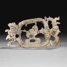 maya openwork shell ornament, Late Classic, ca. A.D. 550-950. Sotheby's.