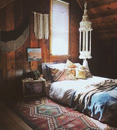 Bohemian. Love the rug and pillows.