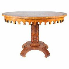 """Anchored by a hand-carved pedestal base, this vintage burl wood table stuns with its diamond-inspired inlay top and scalloped apron.  Product: TableConstruction Material: Burl woodColor: BrownDimensions: 29"""" H x 29.5"""" DiameterNote: Due to the vintage nature of this product, some wear and tear is to be expected. Products may show signs of brand marks, scrapes or other blemishes.Cleaning and Care: Wipe with damp cloth"""