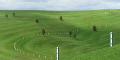 Daniel Buren Green and White Fence, 1999 / 2001 Fence posts at 4m intervals, painted green and white 87mm stripes 3.2km long. Gibbs Farm, New Zealand