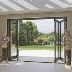 Bi-folding Timber Doors with Bronze Inserts : Puertas de Architectural Bronze Ltd