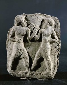 Terracotta relief of two Mesopotamian boxers, c. 2000 B.C.E. from Eshnunna, (Modern-day Tell Asram, Iraq).