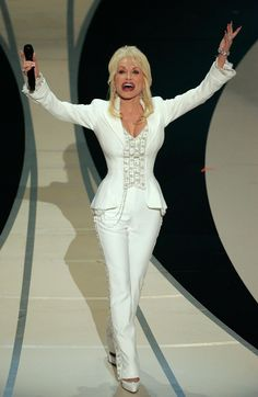 A Tribute to Dolly Parton's Working-Girl Style: Performing in a perfect pantsuit onstage at the 78th Academy Awards in Hollywood, California, in 2006.
