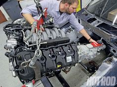 Thinking about switching a Coyote into your ride? Make sure to check out our Ford Coyote Engine Swap Guide as we do all research for you. See it right in the June 2013 issue of Hot Rod Magazine. Engine Swap, Car Engine, Ford Racing Engines, Fox Mustang, 1967 Mustang, Mustang Cars, 2013 Ford Explorer, Mustang Engine, Performance Engines