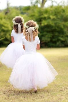 """Long tutus, ballet slippers and white leotards, not too crazy about the baby's breath """"crowns""""-- I think I'd rather a pretty little white bow or side braid. <3 What do you think @Sheena Birt Clark?"""