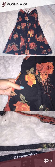 Black floral fall dress Burnt orange floral print in black dress. Key hole back button detailing in the front and back. Perfect condition. Brandy Melville like style Insight Dresses