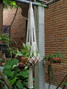 "Two pieces of 2 arms Macramé Plant Hanger in Extra-X set; The first hanger Extra X in natural white unbleached poly cotton twisted cord (off- white color), perfect for 8- 9"" (20-23 cm) diameter x 4(10 cm) height plant pot. The hangers length without pot (top of the hanger to end of its"