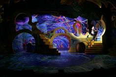 Seussical cool set idea. I like the dark lighting and fun shapes used throughout the set pieces.