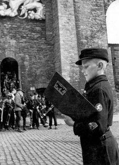 Ghent, Belgium, Flemish Hitler Jugend at a Flemish NSDAP Flag Raising Ceremony . 20 April, 1944.