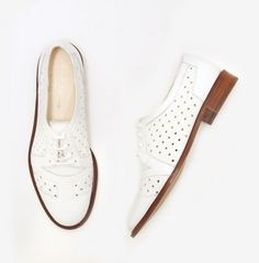 ::obsessed with these white leather perforated oxfords!! Super chic with a some black skinny jeans and a pin stripe shirt::