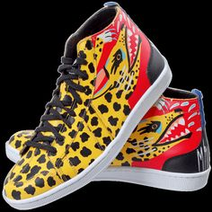 Printed Sneakers / Designed and constructed in Ethiopia, these Sawa sneakers are not essentials, but they are a treat. The riot of paint on the jaguar on the sneakers only adds to their fierceness. Choose a pair for the person who lives in black but likes to go playful from the ankle down.