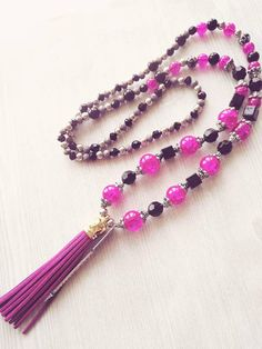 Check out this item in my Etsy shop https://www.etsy.com/ca/listing/562342805/long-tassel-necklace-tassel-and-charm