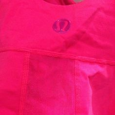 Lululemon Tank Bright reddish pink color (more red than pink by far, just not a true red color). Worn max 3 times, if that. So great, so chic, and of course has support & a small mesh section on the back that is not see through! EXCELLENT condition & a great addition to any closet. lululemon athletica Tops Tank Tops