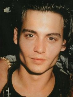 now this is bone structure!! vintage Johnny Depp. :)