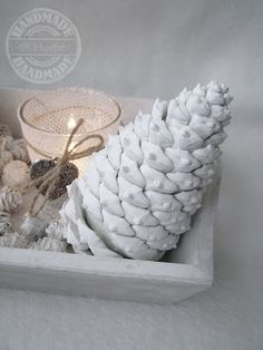Make white pine cones using wall paint. From Bizzy @ Home.