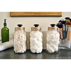 Adding painted wood knobs to the mason jar lids gives storage an apothecary look.  Blog: Liz Marie