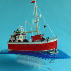 This one is for you, Amy. You could make a copy of your uncle's boat. Lego City, Lego Boat, Lego Ship, All Lego, Cool Lego Creations, Lego Design, Lego Worlds, Lego Group, Fishing