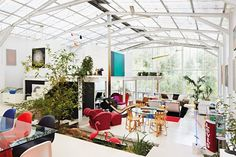 John Henry's Australian home is essentially a white shed designed to house his art and furniture.