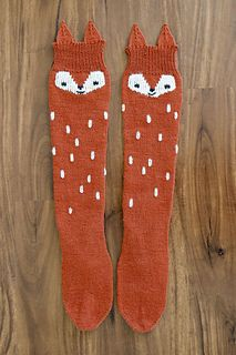 Everyone needs a little fox-in-socks in their life! This whimsical little knit will be sure to bring a smile to your face every time you put them on. They are worked from the toe-up in plain Stockinette stitch so they are a breeze to knit. The white detailing is added after the socks are finished using duplicate stitch. It is a little time consuming but is definitely easier than floating the yarn along the entire circumference of the sock. The duplicate stitching is a bit time consuming, so…